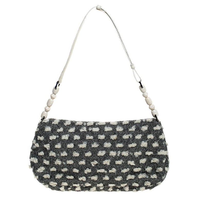 Smart and chic, this Malice shoulder bag by Dior will impress you with its craftsmanship. Spice up your day or evening with this limited-edition shoulder bag that is crafted in fine tweed. It features a shoulder strap accented with white beads and