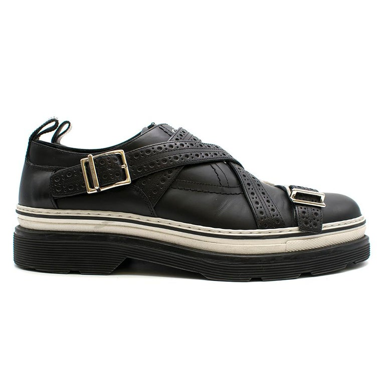 Dior Homme Black Leather Cross Strap Platform Brogues    -Eyelets and Buckles in silver  - Textured Cross Straps   -White Trimming above Platform sole  -Made in Italy   Materials   Exterior - Leather  Interior - Leather  Sole - Rubber