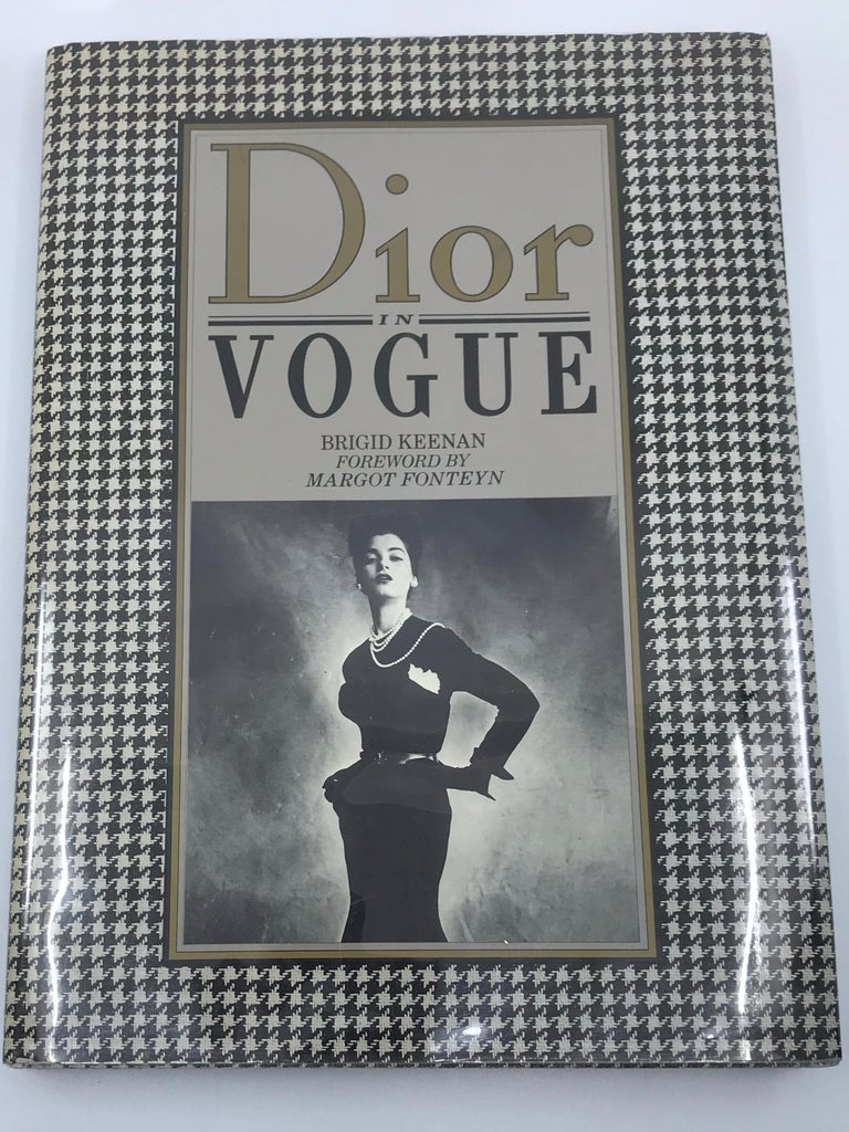 Dior in Vogue book. Vintage hardcover Harmony first edition book on Dior's rise in the fashion world, his influences and inspiration on his collections from 1947-1957; well documented with all his black and white coverage in Vogue. Brigid Keenan,