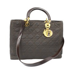 Dior Lady Dior handbag in brown canvas and leather finishes, with shoulder strap