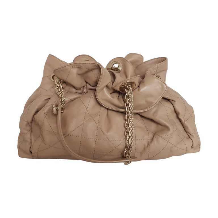 Beautiful Dior bag Very soft leather, nappa Beige color Rouches Handles with golden chains An internal zip pocket Cm 41 x 22 x 14 (16.1 x 8.7 x 5.5 inches) Internal stain as in the photo Worldwide express shipping included in the price !