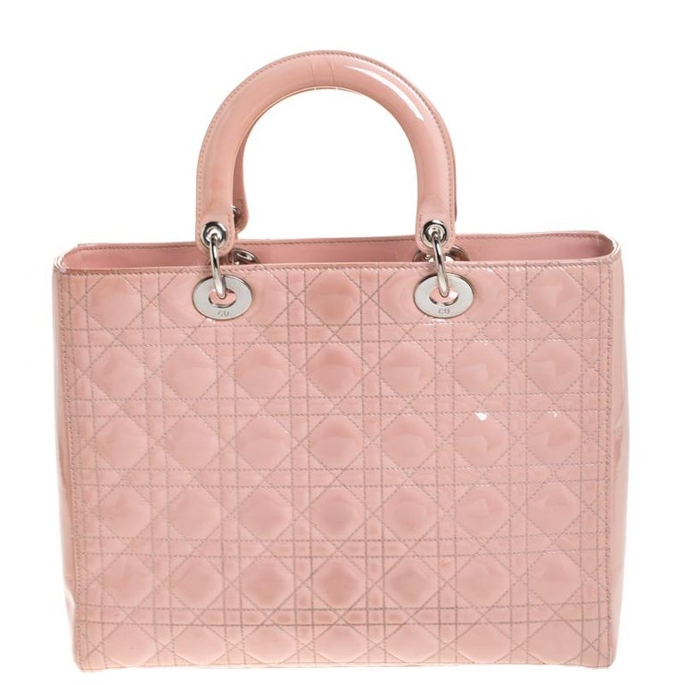 The Lady Dior tote is a Dior creation that has gained recognition worldwide and is today a coveted bag that every fashionista craves to possess. This pink tote has been crafted from patent leather and it carries the signature Cannage quilt. It is