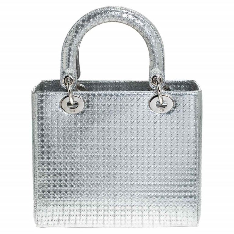The Lady Dior tote is a Dior creation that has gained recognition worldwide and is today a coveted bag that every fashionista craves to possess. This metallic silver tote has been crafted from patent leather and it carries the micro Cannage quilt.