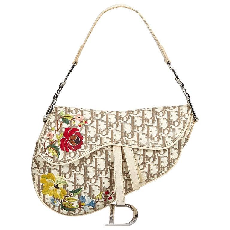 8c1f78103cb5 Dior Monogram Floral Oblique Canvas Saddle Bag For Sale at 1stdibs