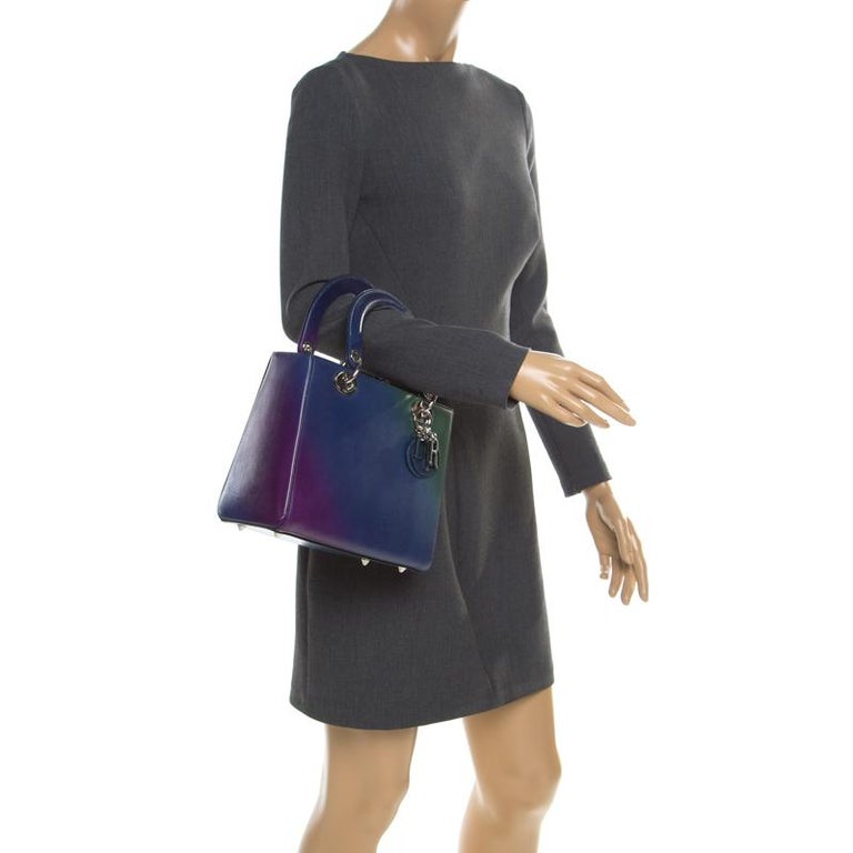 The Lady Dior tote is a Dior creation that has gained recognition worldwide and is today a coveted bag that every fashionista craves to possess. This multicolored omber piece has been crafted from leather and it carries the signature Cannage quilt.