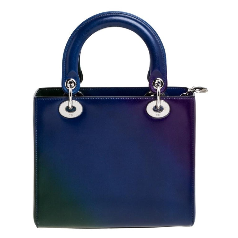 The Lady Dior tote is a Dior creation that has gained recognition worldwide and is today a coveted bag that every fashionista craves to possess. This tote has been crafted from leather and carries a multicolored ombre pattern. It is equipped with a