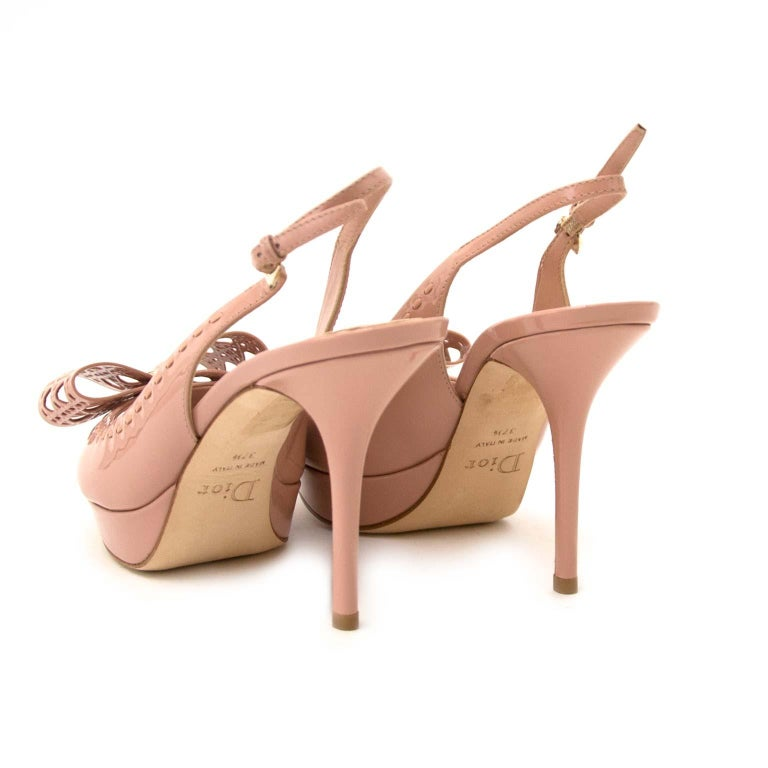 Very good condition  Dior Patent Leather Butterfly Slingback Heeled Sandals - Size 37.5  Add these Dior Butterfly Slingback Sandals to your wardrobe to create a sophisticated polished look.   These beauties are made from glossy patent leather and