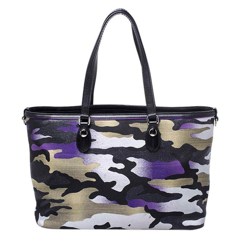 This bag was designed for Dior by Anselm Reyle, an artist from Berlin. He mixed colours and camouflage prints on canvas to create this stunning tote. The Cannage pattern is also laid in a slanting manner for a sense of movement. The bag is held by
