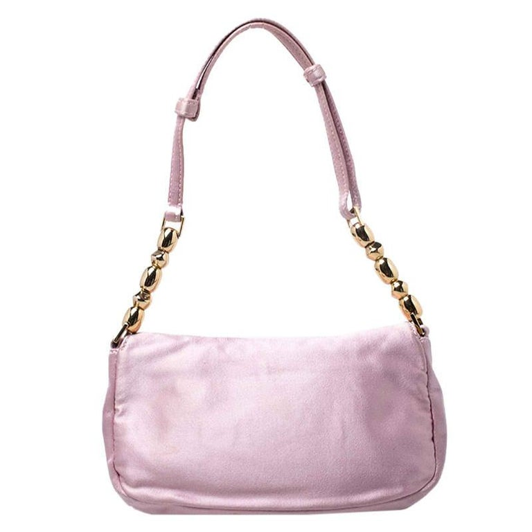 This beautifully fashioned satin bag will surely fetch you a lot of admiration. This piece has a single handle and an ideally-sized fabric interior. You are sure to love this absolutely stylish accessory from Dior.  Includes: Original Dustbag,