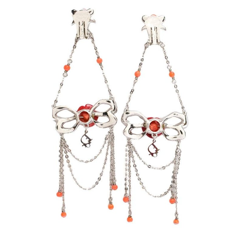 Pretty earrings to complete your feminine looks. These earrings from Dior, which are not just lovely-looking but truly versatile as well will complement all your outfits gorgeously. Designed in a long style, they feature a silver-tone body and a