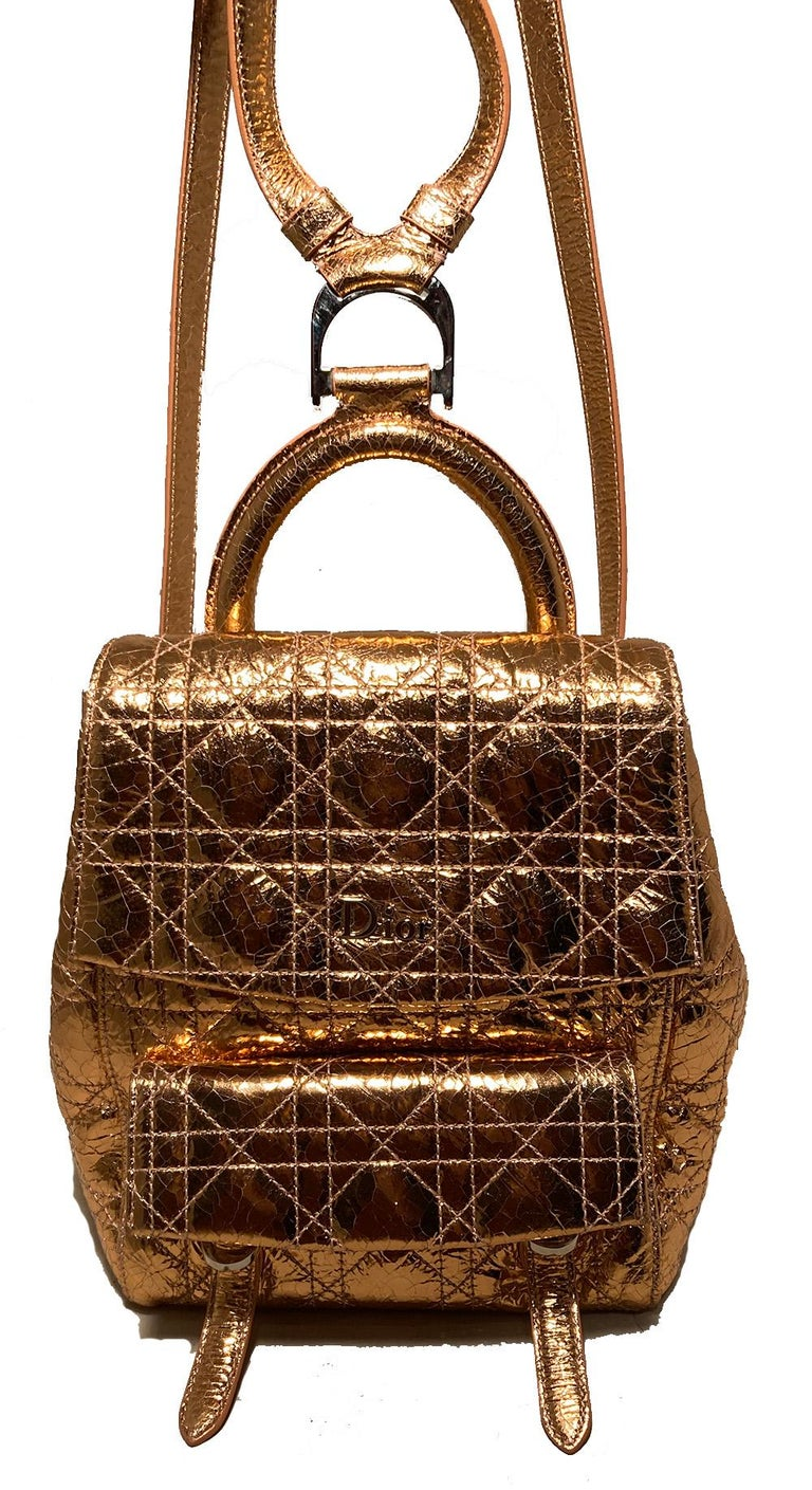 Dior Stardust Rose Gold Leather Backpack in excellent condition. Metallic rose gold crackled patent leather exterior quilted in classic dior cannage style and trimmed with silver hardware. Front double buckle flap pocket. Back slit pocket. Double