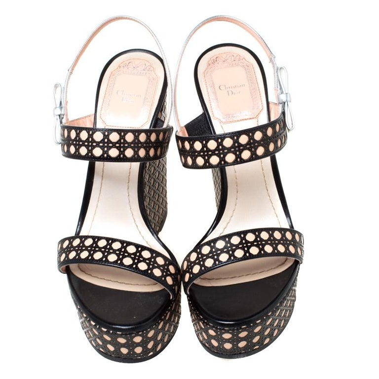 Look you casual best as you step out in these leather sandals. These trendy sandals carry the signature Cannage pattern on the straps at the vamps as well as on the wedge heels. This classic pair by Dior is a closet staple for any woman. These
