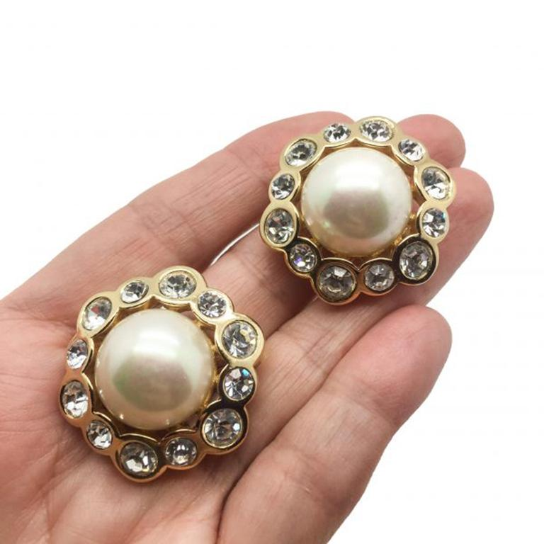 A classic piece of Dior Jewellery oozing full on timeless glamour. These Vintage Dior Pearl Earrings feature a wonderful half pearl surrounded by the most captivating Swarovski rhinestones. All set in a richly gold plated metal that is exceptional