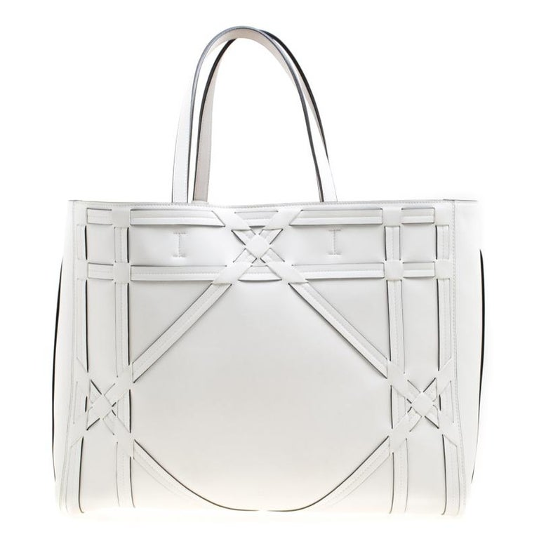 An absolute delight, this shopper tote is a Dior creation. Crafted from leather, the bag features the signature Cannage detail, two shoulder handles and a suede interior sized perfectly to hold your essentials. This shopper tote is accompanied by a