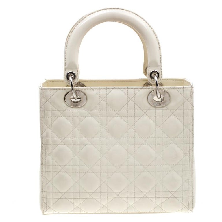 The Lady Dior tote is a Dior creation that has gained recognition worldwide and is today a coveted bag that every fashionista craves to possess. This white tote has been crafted from patent leather and it carries the signature cannage quilt. It is