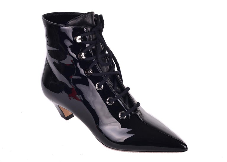 45dcbaba4adc Christian Dior s I-Dior ankle boots. These boots feature an all over  patented design