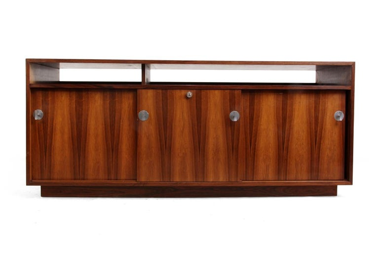 Diplomat sideboard in rosewood by Finn Jhul A rosewood sideboard from the Diplomat series designed by Finn Juhl produced by Cado in Denmark in the mid-1960s three Sliding doors with Aluminum handles and adjustable shelves behind very good quality