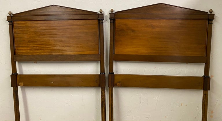 Classic Directoire style twin mahogany headboards with triangular design top and balustrade columns.