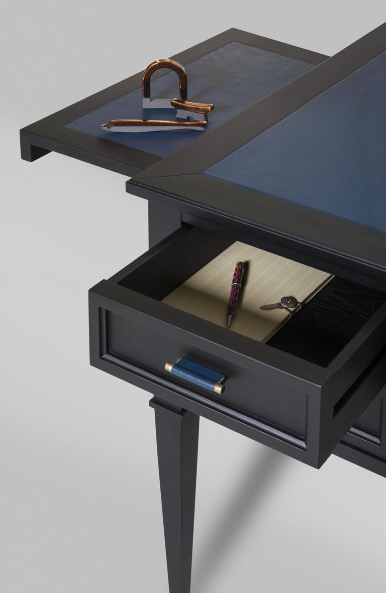 Writing desk made of cherrywood with drawers and leather top Available in different finishes and leather colors. Measures: L 114, W 58, H 80 cm.