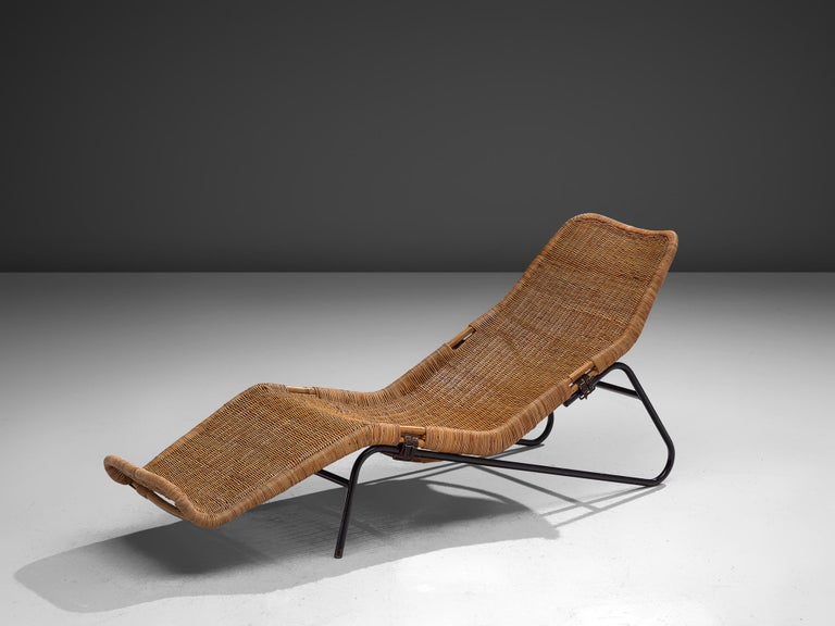 Dirk van Sliedregt for Jonkers, daybed, wicker, metal and leather, the Netherlands, 1950s  Functionalist chaise lounge designed by Dirk van Sliedregt. The crafted rattan seat with an organic shape, following the curves of the human body. The