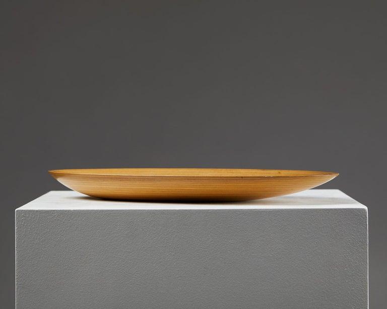 Dish designed by Tapio Wirkkala, Finland, 1950s. Laminated birch.  Signed.  Measures: W 19.4 cm/ 7 2/3