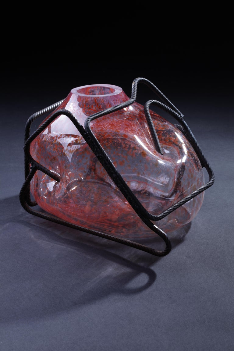 Ferrari is a piece of art designed and realized by Lorenzo Passi, hand blown in a metal structure composition with the use of transparent and red glass. Every artwork made by the artist is a unique piece. Ferrari is a caricature of an iconic Italian