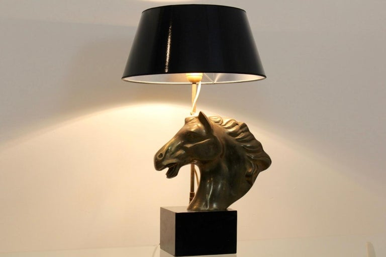 Unique and beautiful midcentury brass horsehead table lamp from the 1970s. The lamp is made in France and unique and has a sophisticated appearance. The beautiful black shade combined with the black marble base strengthens the horse's distinctive