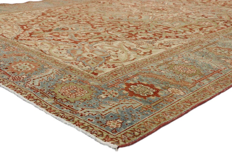 52670, distressed antique Persian Heriz Design rug with Rustic Artisan Cottage style. This hand knotted wool distressed antique Persian Heriz design rug features a large lobed floral medallion with anchor pendants floating in the center of an