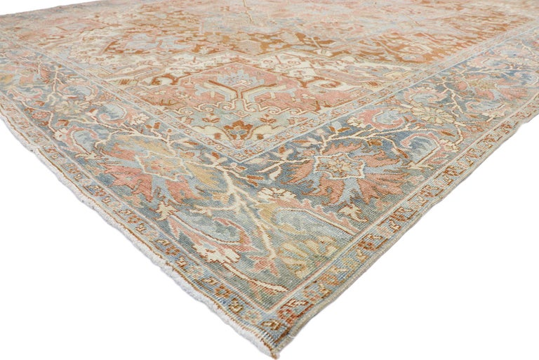 52671, distressed antique Persian Heriz Design rug with Rustic Artisan style. This hand knotted wool distressed antique Persian Heriz design rug features a large octofoil medallion with anchor pendants floating in the center of an abrashed terra