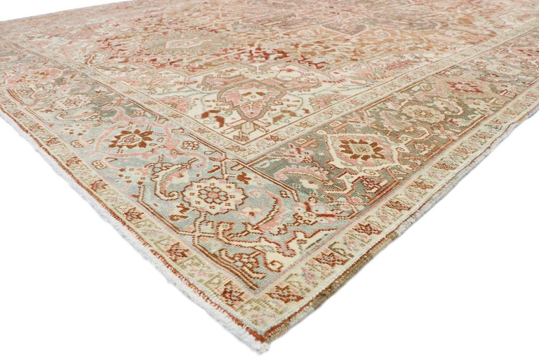 52667, distressed antique Persian Heriz Design rug with Rustic Arts & Crafts style. This hand knotted wool distressed antique Persian Heriz design rug features a large octofoil center medallion with flaming palmette pendants floating on an abrashed