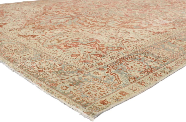 52668, distressed antique Persian Heriz Design rug with Rustic Bungalow style. This hand knotted wool distressed antique Persian Heriz design rug features a large octofoil medallion with flaming palmette pendants floating in the center of an