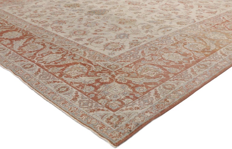 52435 Distressed Antique Persian Isfahan Rug with Relaxed Federal Style, Esfahan Rug. This hand knotted wool distressed antique Persian Isfahan rug features an all-over Herati pattern of muted blossoming palmettes, rosettes, curved sickle leaves,