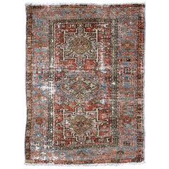 Distressed Antique Persian Karadjeh Rug with Geometric Medallions and Accents