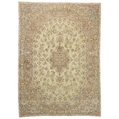 Distressed Antique Persian Kerman Rug with French Provincial and Georgian Style