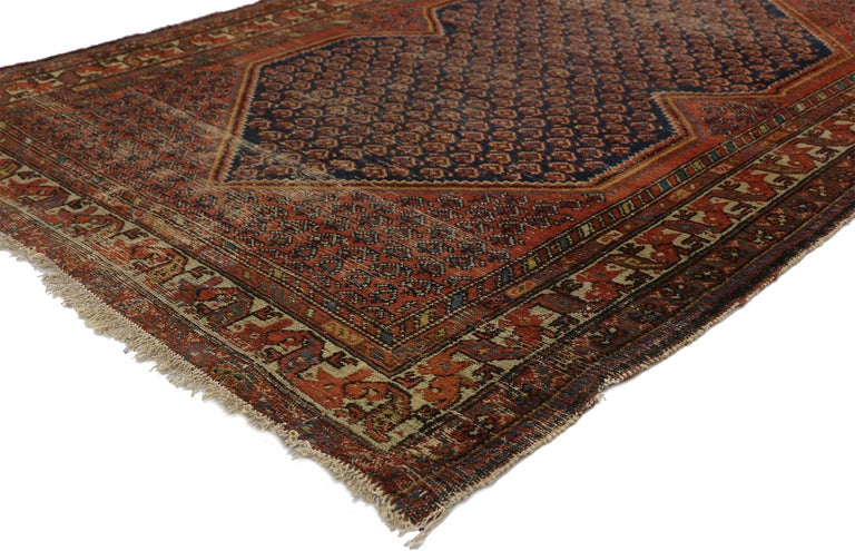 77251 distressed antique Persian Malayer rug with Rustic Artisan and Industrial style. With architectural elements combined with a weathered composition, this hand knotted wool antique Persian rug embodies a rustic Artisan style with MCM vibes. This