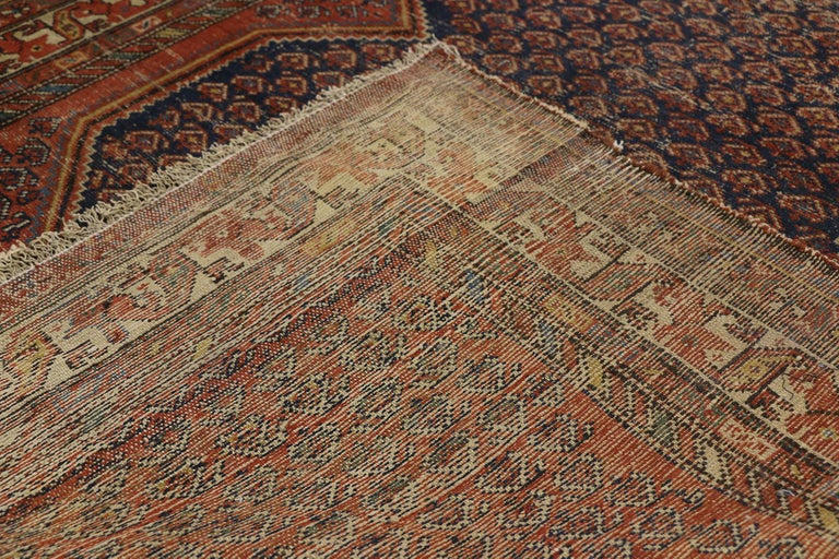 20th Century Distressed Antique Persian Malayer Rug with Rustic Artisan and Industrial Style For Sale