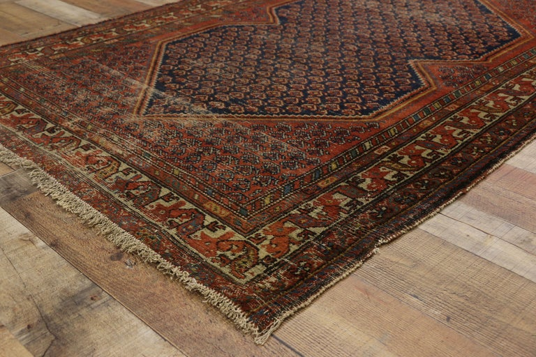 Wool Distressed Antique Persian Malayer Rug with Rustic Artisan and Industrial Style For Sale