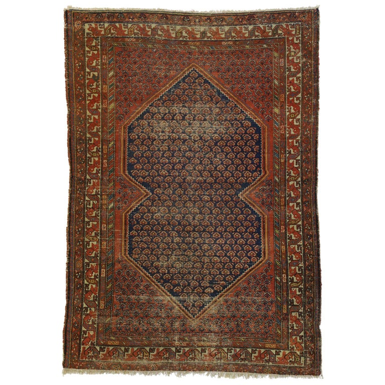Distressed Antique Persian Malayer Rug with Rustic Artisan and Industrial Style For Sale