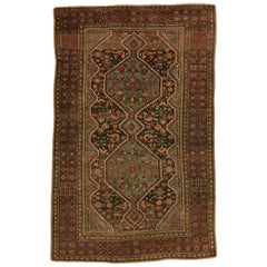 Distressed Antique Persian Shiraz Rug with Rustic Tribal Style