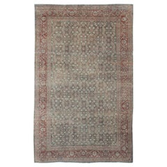 Distressed Antique Persian Sultanabad Rug in Faded Blue Background