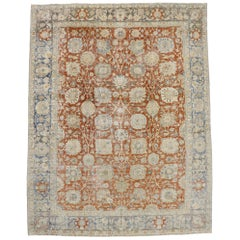 Distressed Antique Persian Tabriz Rug with Rustic Colonial Style