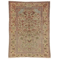 Distressed Antique Turkish Hereke Rug with Rustic English Country Cottage Style