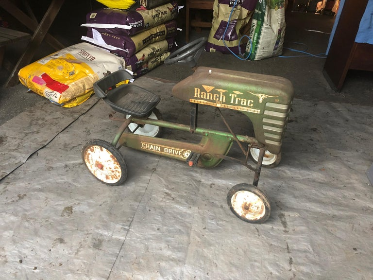 A fabulously distressed old tractor pedal toy car with lots of character and great patina. Meant for display to add a taste of the pasture.