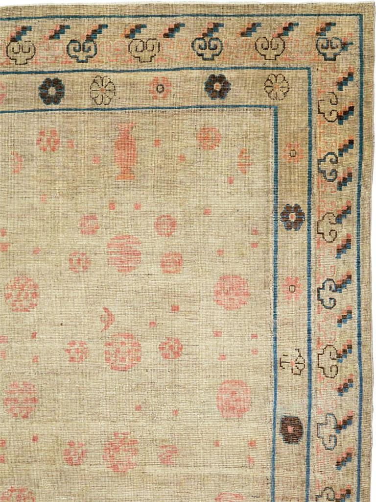 Hand-Knotted Distressed East Turkestan Khotan Gallery Carpet in Beige, Pink and Blue For Sale