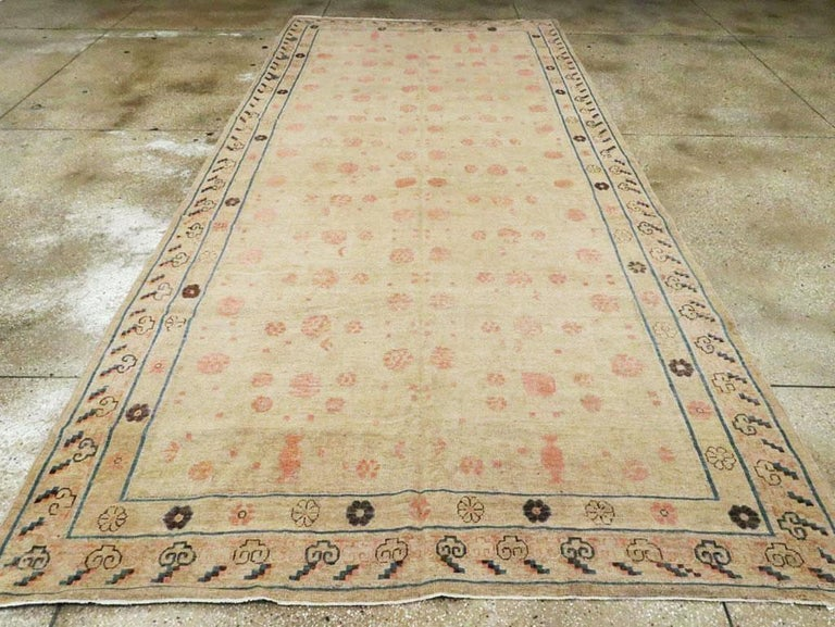 Distressed East Turkestan Khotan Gallery Carpet in Beige, Pink and Blue In Good Condition For Sale In New York, NY