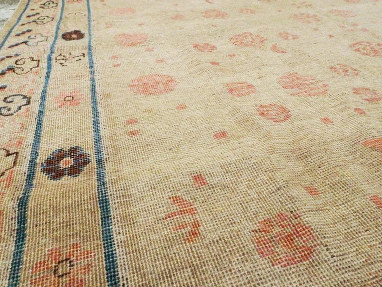 20th Century Distressed East Turkestan Khotan Gallery Carpet in Beige, Pink and Blue For Sale
