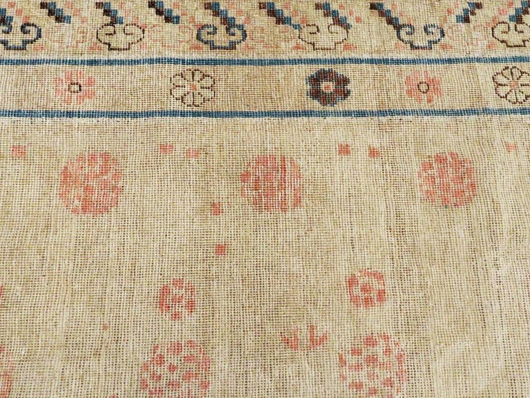 Distressed East Turkestan Khotan Gallery Carpet in Beige, Pink and Blue For Sale 1