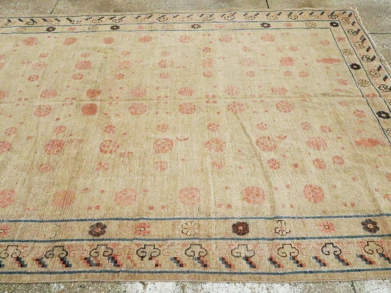 Distressed East Turkestan Khotan Gallery Carpet in Beige, Pink and Blue For Sale 2