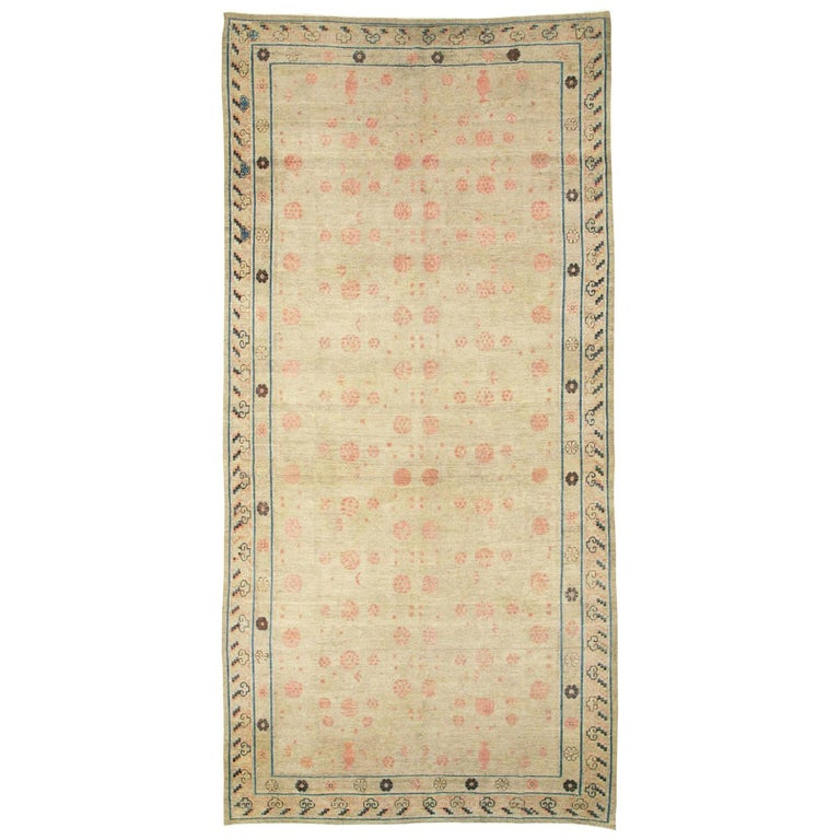 Distressed East Turkestan Khotan Gallery Carpet in Beige, Pink and Blue For Sale