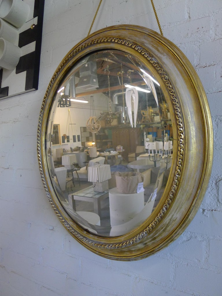 American Distressed Gilt Oval Antiqued Mirror Hung by Rope For Sale